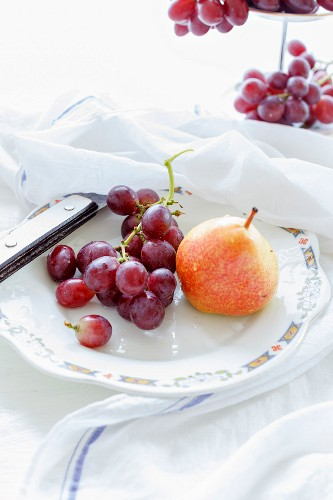 Grapes and pears on a plate