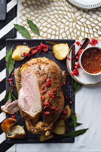 Roast duck with a spicy orange and raspberry sauce (sliced)