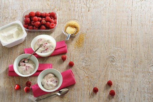 Raspberry quark with ingredients on a wooden surface