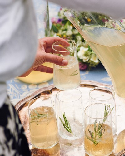 Rosemary drinks being poured into glasses