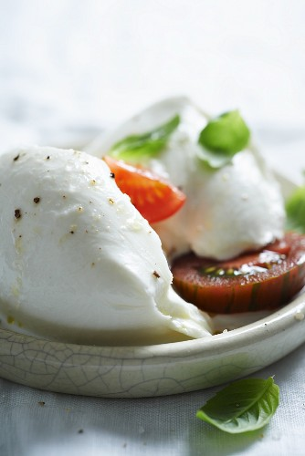 Mozzarella with zebra tomatoes and basil