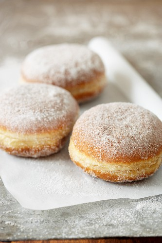 Three doughnuts on a piece of paper