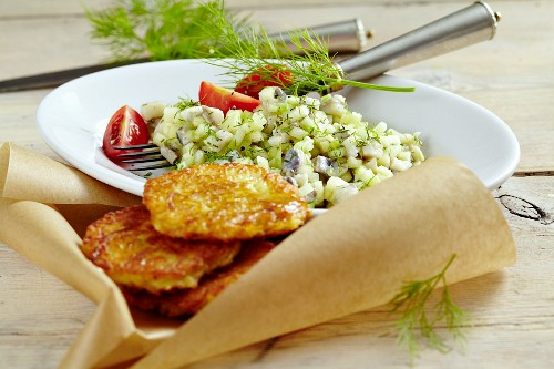 Herring salad with potato fritters