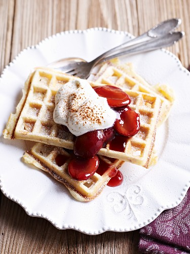 Waffles with plum compote and whipped cream