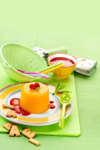 Mango flans with red fruit sauce