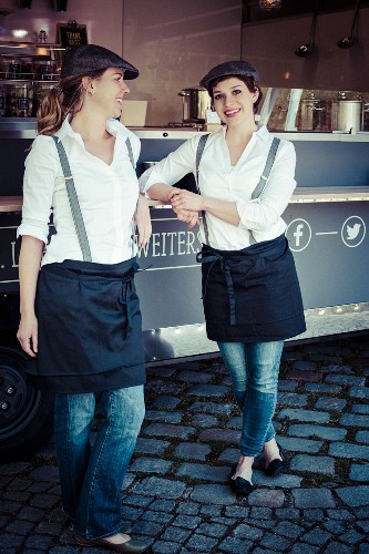 Two women in front of a food truck