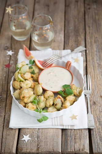 Beer battered brussels sprouts with a yoghurt and grapefruit sauce