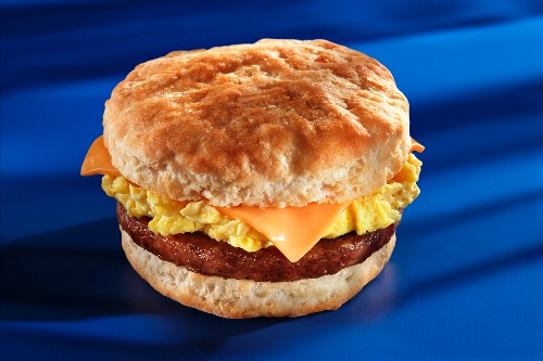 Fried sausage, cheese and scrambled egg on an American biscuit