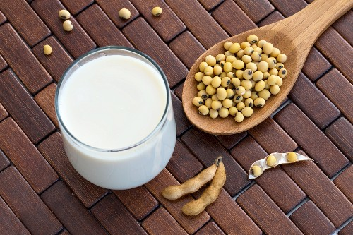A glass of soya milk and soya beans