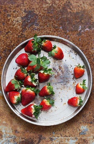 Fresh strawberries on a silver tray