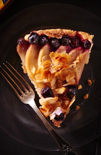 A slice of fruit tart with almonds