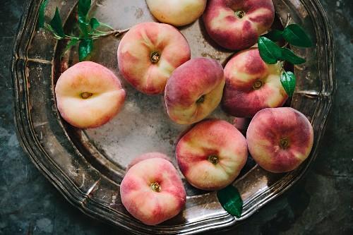 Vineyard peaches on a silver plate