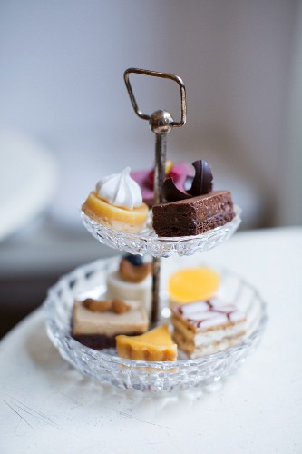 Petits fours on a cake stand at the Kapstachelbeere cafe and patisserie, Berlin