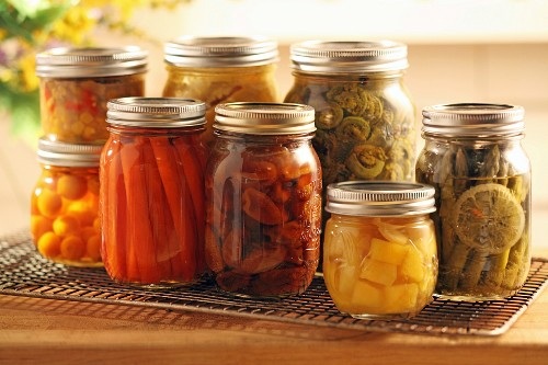 Pickled fruit and vegetables in screw-top jars