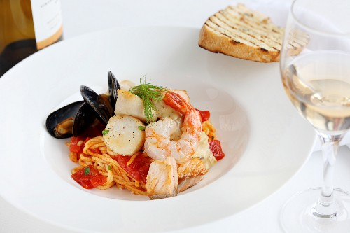 Pasta with tomatoes, fish and seafood