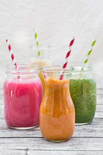 For different smoothies in glasses with straws