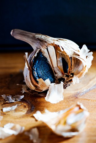 Black garlic on a wooden table