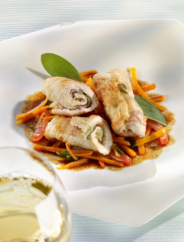 Veal rolls on a carrot salad with sage
