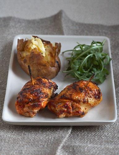 Spicy devil's chicken with a baked potatoes