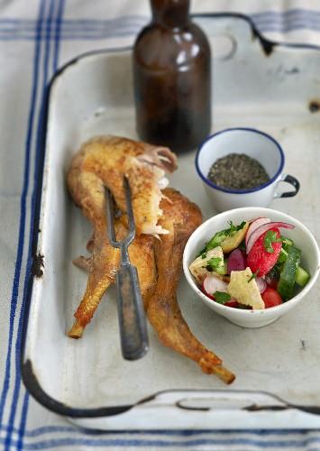 Roast chicken legs with salad