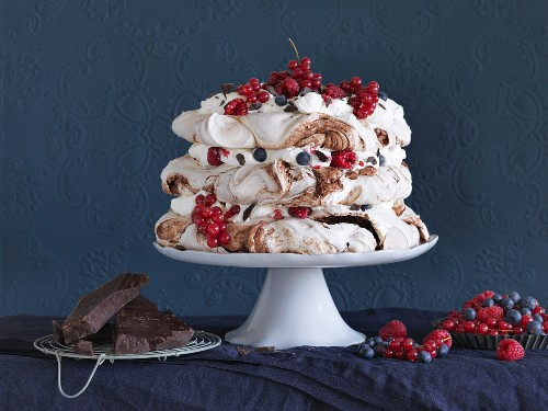 Chocolate pavlova with meringues and berries