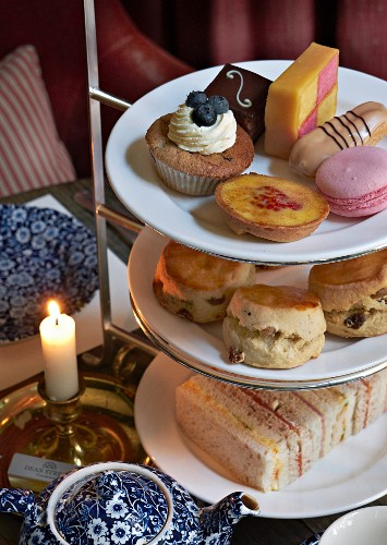 Sandwiches and cakes on a stand for teatime