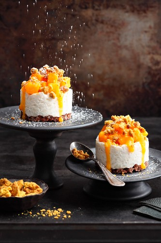Coconut rice cakes with mango and peanut curry crumbles