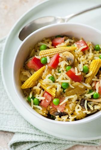 Savoury rice with mushrooms and baby sweetcorn