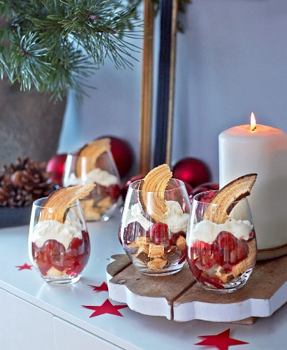 Baumkuchen (German layer cake) and cherry trifle in desert glasses for Christmas