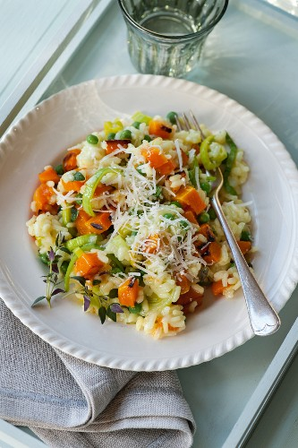 Butternut squash and pea risotto with grated cheese