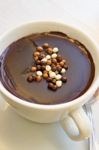 Italian hot chocolate sprinkled with crispy chocolate pearls
