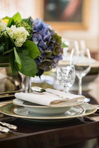 Elegant place setting with blue hydrangeas for a celebratory dinner