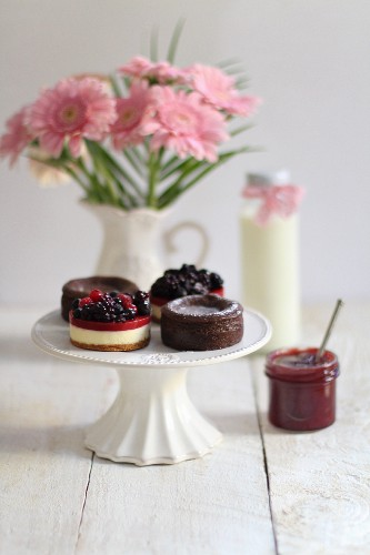 Chocolate cakes, berry tartlets and a jar of jam