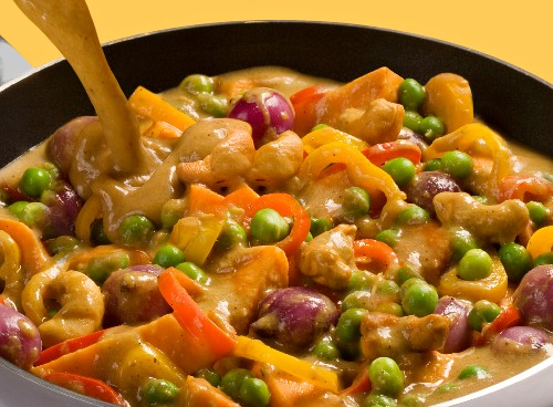 Chicken curry with peas, peppers, purple potatoes and cashew nuts