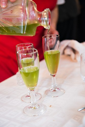 An aperitif being poured