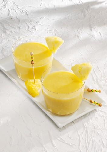 Banana colada smoothie made with bananas, pineapple, coconut milk and yoghurt