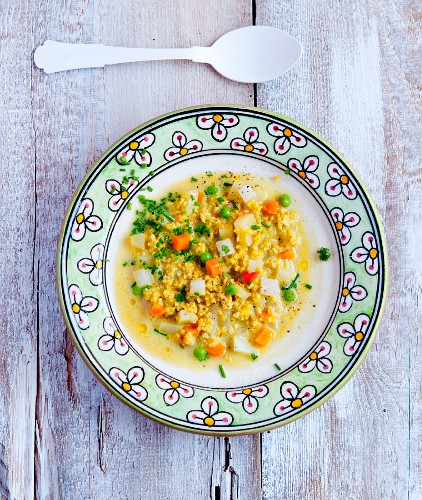 Millet and vegetable soup with chives