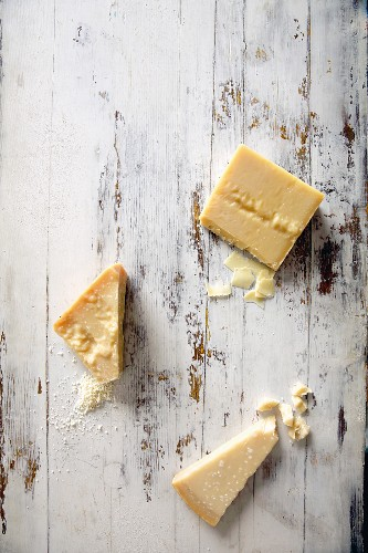 Pieces of Parmesan cheese of different ripenesses