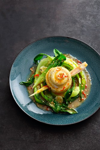 Steamed sole rolls on bok choy and an apple and curry sauce