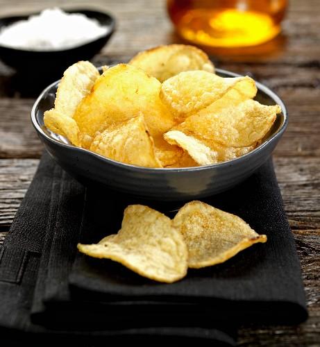 A bowl of sea salt and apple vinegar crisps