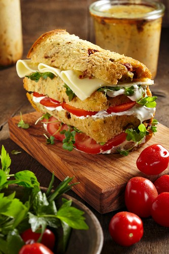 Herb bread with tomatoes and feta cheese baked in a glass