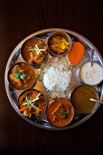 Thali with chicken, lamb, lentil soup, pickles, curried vegetable and rice (Nepal)