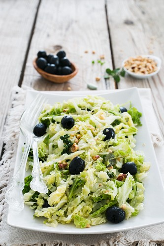 Savoy cabbage salad with black olives and hazelnuts