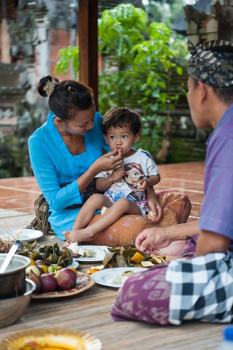 And oriental family eating on a terrace