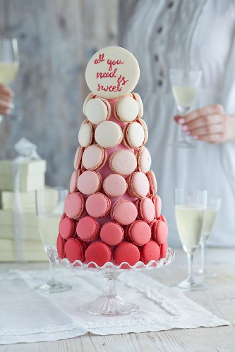 A festive macaroon pyramid with champagne