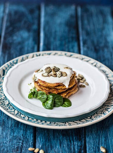 Gluten-free pumpkin pancakes with quince and pumpkin seeds
