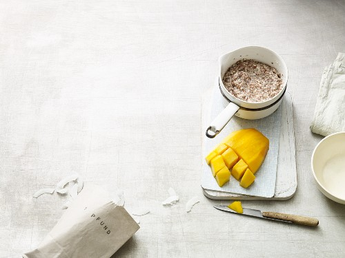 Porridge with flax seeds, chia seeds, nuts, coconut milk and mango (Paleo diet)