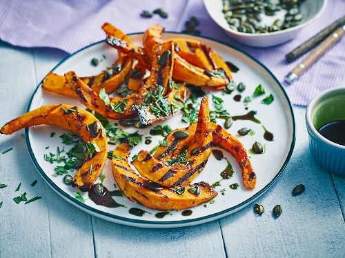 Grilled Hokkaido pumpkin wedges with crispy pumpkin seeds