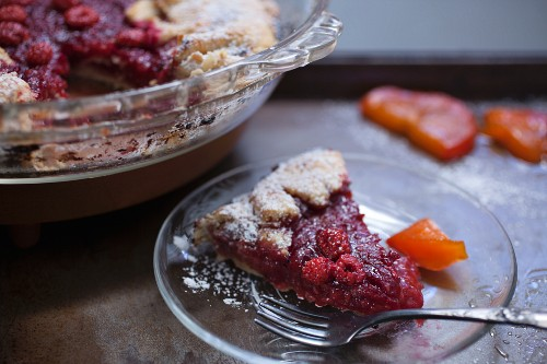 Rustic wild raspberry and persimmon tart, sliced
