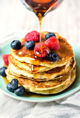 American-style pancakes with fresh berries and maple syrup